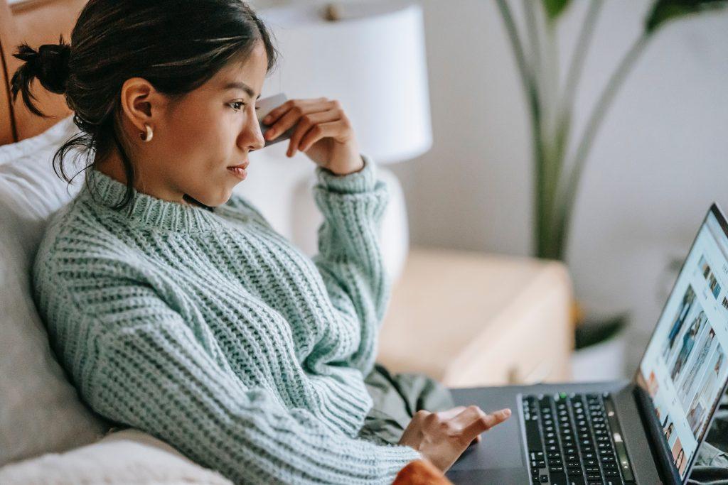 woman shopping ecommerce on laptop